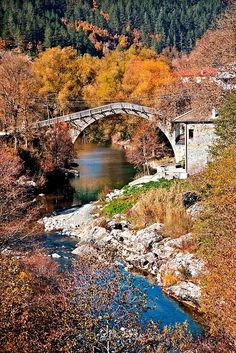 """The old stone bridge over Aoos river at Vovoussa village, Zagori region, Ioannina, Epirus, Greece. Vovoussa is the perfect """"base"""" to explore the National Park of Valia Calda • Millions of unique designs by independent artists. Find your thing. Love Bridge, Old Stone, Hercules, Bridges, Travel Mug, Greece, National Parks, Old Things, Base"""