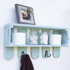 Shelf with hooks on fence pickets from Reclaimed Wood