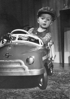 a boy and his ride, circa 1950 | vintage 50s children clothes | little boy in a toy car