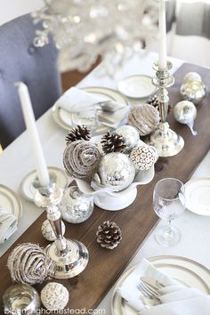 Beautiful winter tablescape featuring a metallic feel with rustic elements. Wouldn't this be a perfect Christmas Tablescape or for any holiday?