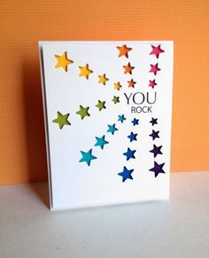 coloured layered behind die cut stars