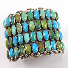 Wide Sterling Silver Cuff Bracelet set with Four Rows of Natural Turquoise, Variscite, and Gaspeite with the Turquoise from a Variety of Mines Including Ajax, R