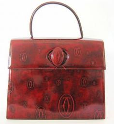 Cartier: 'Happy Birthday' Bordeaux Calfskin Kelly Bag (named after style icon, Grace Kelly).