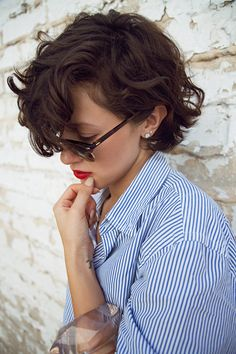 Red lips, blue stripes and chunky bracelet.