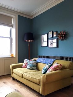 Living room walls painted in Stone Blue, woodwork and ceiling in Strong White. Farrow and ball