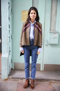 MAN REPELLER- Boxy jacket with button down shirt tucked into high waist raw hem straight leg jeans, and animal print ankle booties