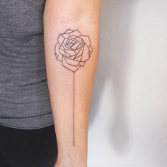 Geometric rose tattoo on forearm by Jessica Channer