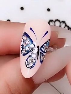 Make such a beautiful manicure this season, you will be more outstanding. Butterfly Nail Designs, Butterfly Nail Art, Rose Nail Art, Floral Nail Art, Gel Nail Art, Nail Art Diy, Gel Nails, Skull Nail Art, Skull Nails