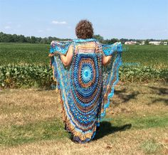 Circle Vest - Bohemian Vest hippie style, Yarn is a mercerized cotton and called Diva Batik. This pattern is the crochet Bohemian Vest and can be found on Ravelry or Craftsy.