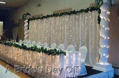 Are You Using String Lights? : wedding backdrop christmas drape lights post wedding party Wedding Head Table