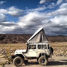 It is a Toyota FJ 40 land cruiser camper!