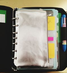 $1 DIY organizer pouch by ashley g 1) pick up dollar store or thrifted pouch (dollar store ones are unlined so easier to punch)  2) put in binder and close to get guides where to punch holes  3) punch! Single hole punch is best unless you have a heavy duty multiple hole punch  4) put stuff in it.   I'm thinking of making an entire binder of just different sized pouches to hold random art supplies