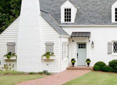 Exterior paint Notice faux window (closed shutters) with window boxes - great for side of garage? Stucco Exterior, Stucco Homes, Cottage Exterior, House Paint Exterior, Exterior Shutters, Exterior Color Schemes, Exterior Paint Colors, White Stucco House, Faux Window