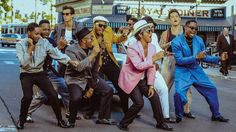 As Mark Ronson and Bruno Mars look set for another week at the top of the charts (both here and in the US), it's clear that 'Uptown Funk' fever shows no signs of vanishing. Mark Ronson, Bruno Mars, Pop Rock, Rock And Roll, Mtv Videos, Music Videos, Pink Tuxedo, Record Of The Year, Uptown Funk