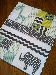 Handmade Baby Quilt with Elephant and Giraffe Applique. $125.00, via Etsy.