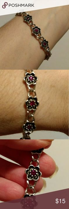 "Vintage Avon fuschia Stone flower bracelet This is a cute vintage (80's) silver with a blackened/aged appearance flower link bracelet. Has hot pink rhinestones in the center of the flowers. 7"" long  Cute with Jeans!!  Perfect pre-owned condition Avon Jewelry Bracelets"