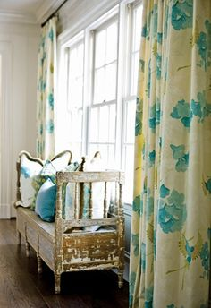 Love the floral aqua drapes accented by the rustic window seat. I want to sit for awhile and soak up the sun!