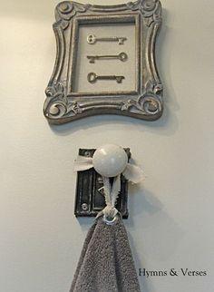I like the hanger but I like a tie on towel idea even better...Old Door Knob Hardware - Hand Towel Holder