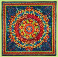 Manic Organic quilt by Lynn Ticotsky.  Complementary blues, oranges, blue-green and golden yellow.