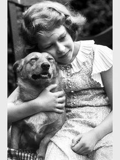 Queen Elizabeth II with her very first Corgi, Dookie, in 1939