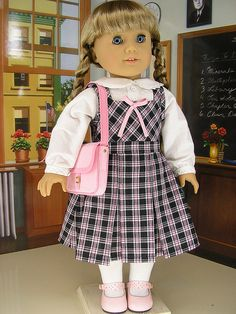Blouse, jumper and book bag made from American Girl's Molly patterns