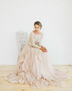 This stunningly jeweled silk batiste blush wedding gown by CathyTelle via etsy has gorgeous ruffles to give your dress a beautiful ball gown look. #blushweddingdress #ruffles