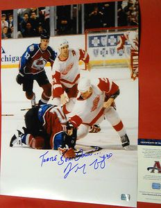 "Rare Autographed Darren McCarty 16 X 20 legendary fight photo with Claude Lemieux. Darren added the incredibly rare inscription ""Turtle BeatDown!!!"". This is Darren McCarty beating down Lemieux for his cheap shot that injured Kris Draper! Darren also included ""25"" for his jersey number. This is one of the most memorable fights and moments in Red Wing history! Any true Detroit Red Wings fan would love to have this fantastic item displayed in their sports room!"
