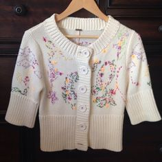 Free People embroidered Sweater M Looks Brand New! So Pretty and well made, nice heavy knit yarn and detailed embroidery throughout has little pulls here and there but it's part of the FP signature design! Size M Free People Tops Button Down Shirts