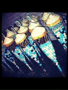 Chocolate candy cake decorations and cupcakes in a wine glass