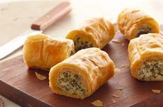 Spinach Phyllo Roll-Ups Kraft -Make Ahead  1 Egg;  1pkg 10 oz of frz spinnage thawed and well drained; 1 c Crumbled Feta Cheese; 1   tub  (8 oz.) PHIL Garden Vegetable 1/3 Less Fat than Cream Cheese;   4 green onions, finely chopped; 15  sheets  frozen phyllo dough (14x9 inch), thawed; 1/3 c  butter, melted  See Recipe.....