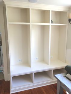 Shelving with cubbies for extra storage. the lower cubbies are perfect for shoes or boots Cubbies, Storage Shelves, Diy Shelving, Shelving Units, Custom Bookshelves, Custom Shelving, Custom Entertainment Center, Diy Entertainment Center, Diy Tv Stand