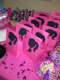 Barbie party I bought a different kind of gift bags don't think my will be Big enough. like these better any way. What U all Think?