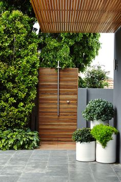 This zen outdoor shower was included in the landscaping by Outdoor Establishments.