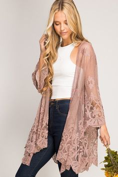 This gorgeous lace kimono is perfect for the spring and even summer. Wear it with jeans or shorts or skirts… You can dress it up or dress it down. Elegant and feminine. 70% cotton, 30% poly cont.