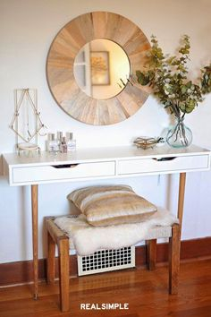 5 of the Best IKEA Hacks for Organizing Small Spaces | Erin from A New Bloom added legs to the wall-mounted EKBY ALEX shelf to create just what she needed: a get-ready station that wouldn't overwhelm her small bedroom and bathroom. With two drawers and a shelf to store all of her toiletries, this DIY vanity is stylish and space-savvy. #decorideas #homedecor #decorinspiration #realsimple #smallspaceideas #apartmentideas