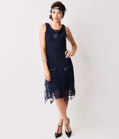 Go totally Gatsby, darling! With this navy Hemingway flapper dress, you can achieve that perfect 1920s look without all of the effort. This fabulous frock features a slightly fitted shape with a narrow waist, V-neck and loose, knee-length skirt, as well a