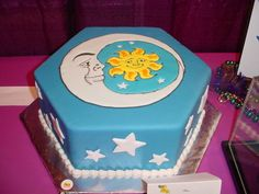 Sun and Moon - This is a cake I took to ICES 2005. The sun and moon were done using color flow.