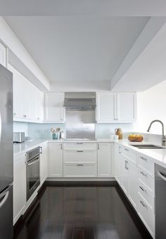 U-Shaped White Kitchen with Stainless Steel Appliances | Remodelista