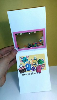 See through shaker window birthday card featuring Lawn Fawn's Monster Mash.  Made by Curl E. Cue's