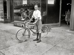 """Washington, D.C., circa 1921. """"Times boy and bicycle."""" One of the winners of a Washington Times subscription-selling contest and his prize, a Mead Ranger bike."""