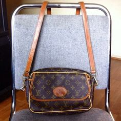 Louis Vuitton cross body bag Authentic true vintage Louis Vuitton cross body bag. This was my moms. Excellent condition for being vintage. Great for any ocassion. Gorgeous piece. Louis Vuitton Bags Crossbody Bags