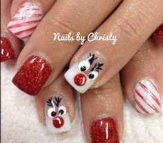 Fashion Nails for Christmas festival #december #winter #red #white #reindeer #candycane #cute  @Leslie Lippi Crouser these are SO cute!