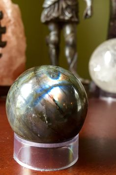 A personal favorite from my Etsy shop https://www.etsy.com/listing/274091564/luminescent-labradorite-sphere-crystal