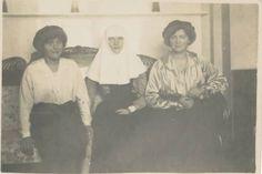 Grand Duchesses Anastasia, Tatiana in Red Cross nurses uniform, Marie