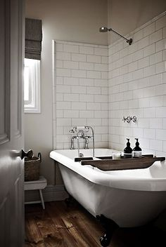 Nice subway tile. Spacious, vintage-looking combo tub/shower. Pretty sure water would be everywhere, especially on the beautiful hardwood floors.
