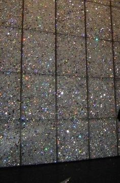 Glitter tiles. Can you imagine this as a master bath floor? I'd live in there.