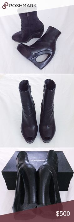 Ann Demeulemeester boots pre-owned , still in perfect condition with original box and dust bag. only worn 2-3 times. I'm a size 5.5 . Ann's shoes always run half or a full size bigger. These run half size bigger to me. Ann Demeulemeester Shoes Ankle Boots & Booties
