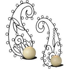 $23.49 - Fun wall sconces add pizazz to any room in your home Decorative accessories feature a paisley design with a black finish Candle holders add a soft glow to your home decor -- This is so cute and would look great in the Master Bedroom with the bedding I pinned! :)
