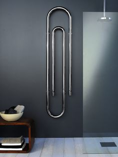Towel warmer shaped like a paper clip. Cool art looking piece, but not sure how ., Towel warmer shaped like a paper clip. Cool art looking piece, but not sure how towels would hang well on this one.