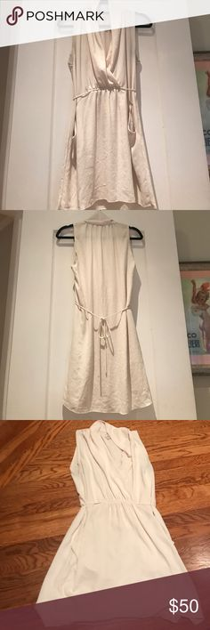 Wilfred White Dress This Wilfred white tie dress is perfect for any occasion! Ties in the back to provide the dress with a cute fit. The style is very cute and the dress has pockets. Minimal wear, exceptional condition. Wilfred Dresses
